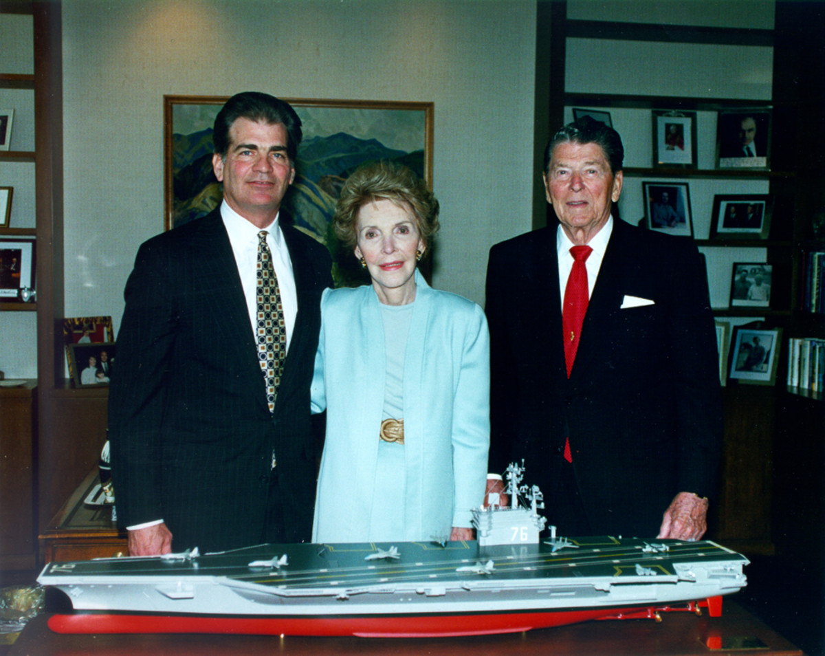 Former President Ronald Reagan and First Lady Nancy Reagan, as well as Newport News Shipbuilding Chairman and CEO Bill Fricks stand behind the model of the aircraft carrier USS Ronald Reagan (CVN-76).