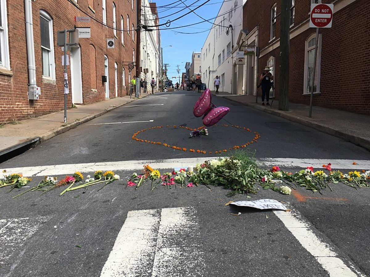 Some are willing to kill for their tribe. A floral memorial to Heather Heyer who died at the hands of a white supremacist in Charlottesville, Virginia.