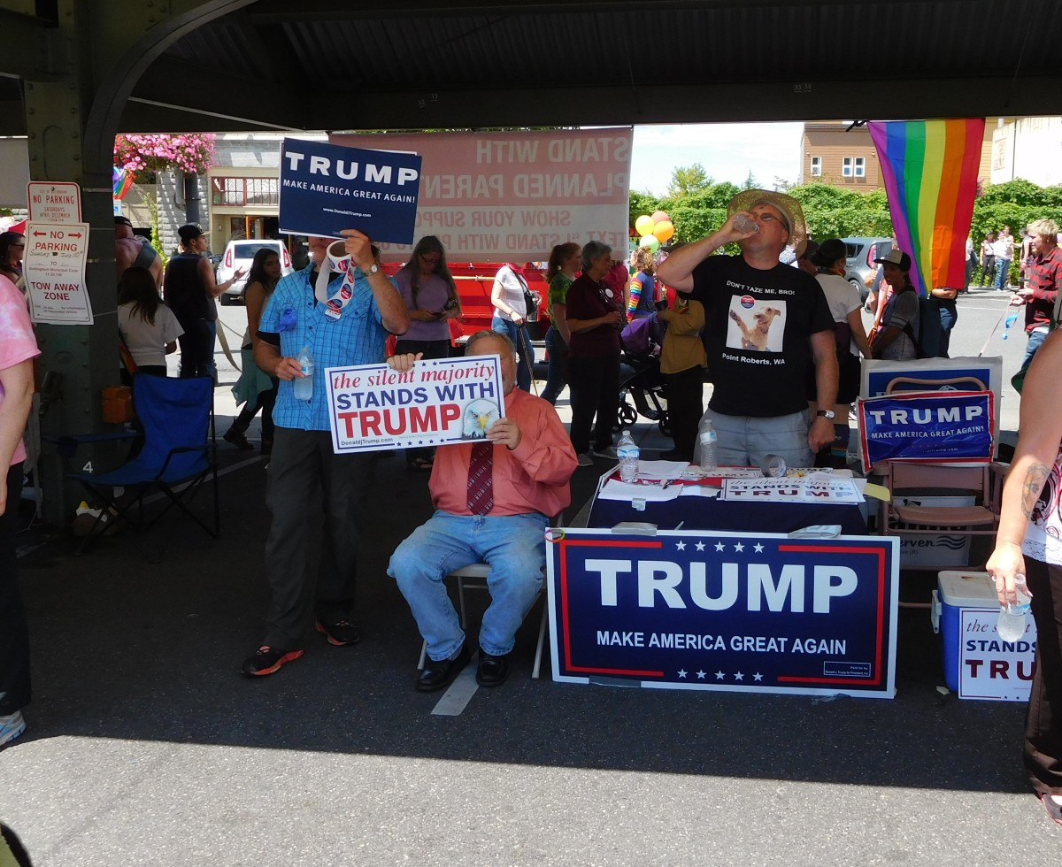 Gay white men campaigning for an anti-gay candidate at at Bellingham Pride Festival, July 11, 2016. Photo by Robert Ashworth, CC 2.0