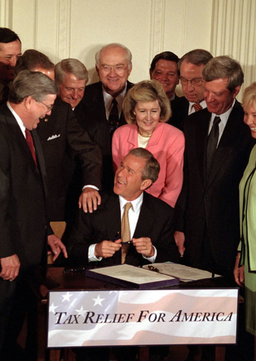 President George W. Bush signs the tax bill on Thursday, June 7 in the White House