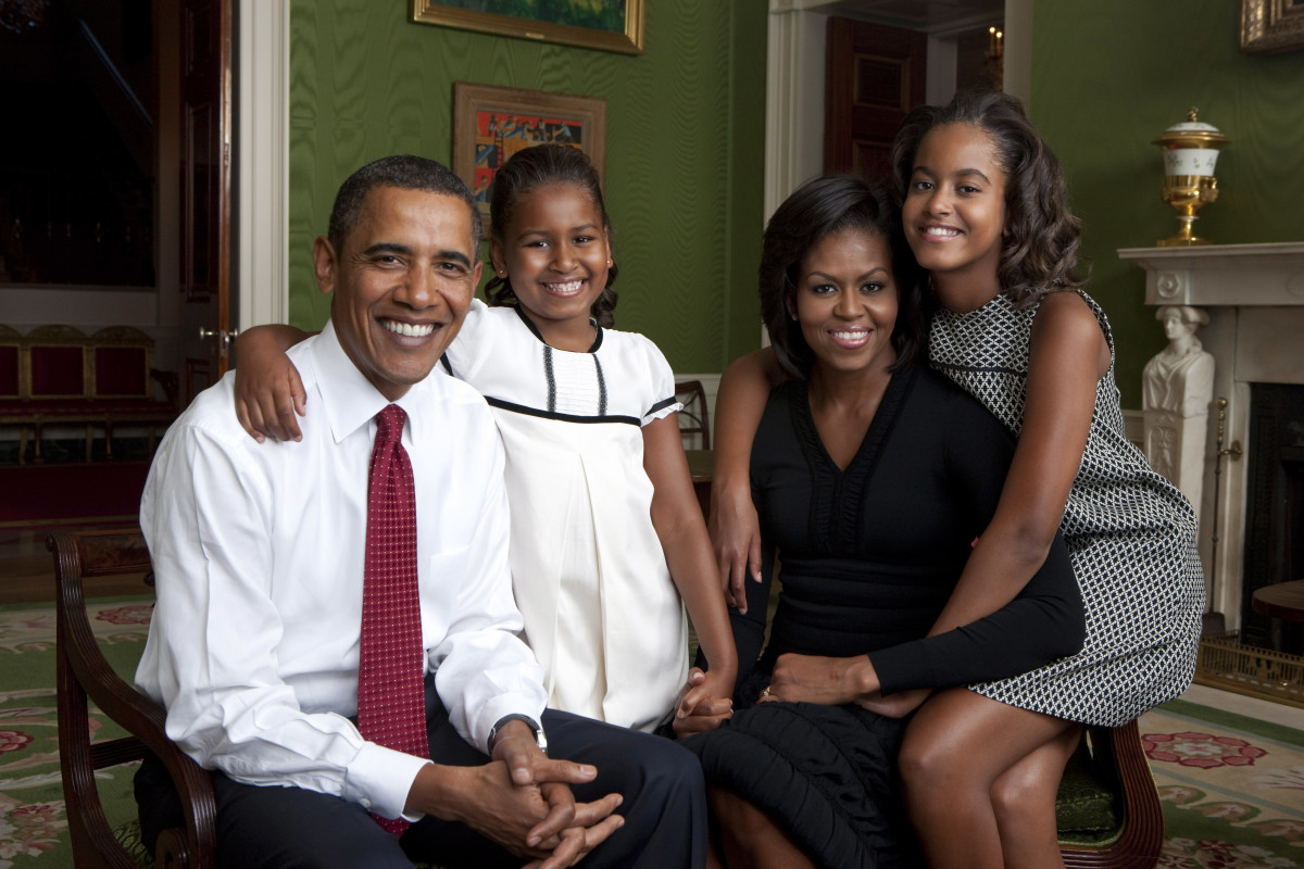 President Barack Obama, First Lady Michelle Obama, and their daughters, Sasha and Malia, sit for a family portrait in the Green Room of the White House, Sept. 1, 2009.