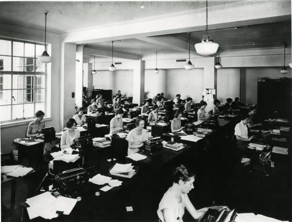 The old typing pool, now obsolescent in light of changes in computer technology.