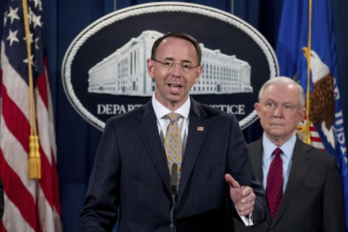 Deputy AG Rosenstein, with Attorney General Jeff Sessions behind him.