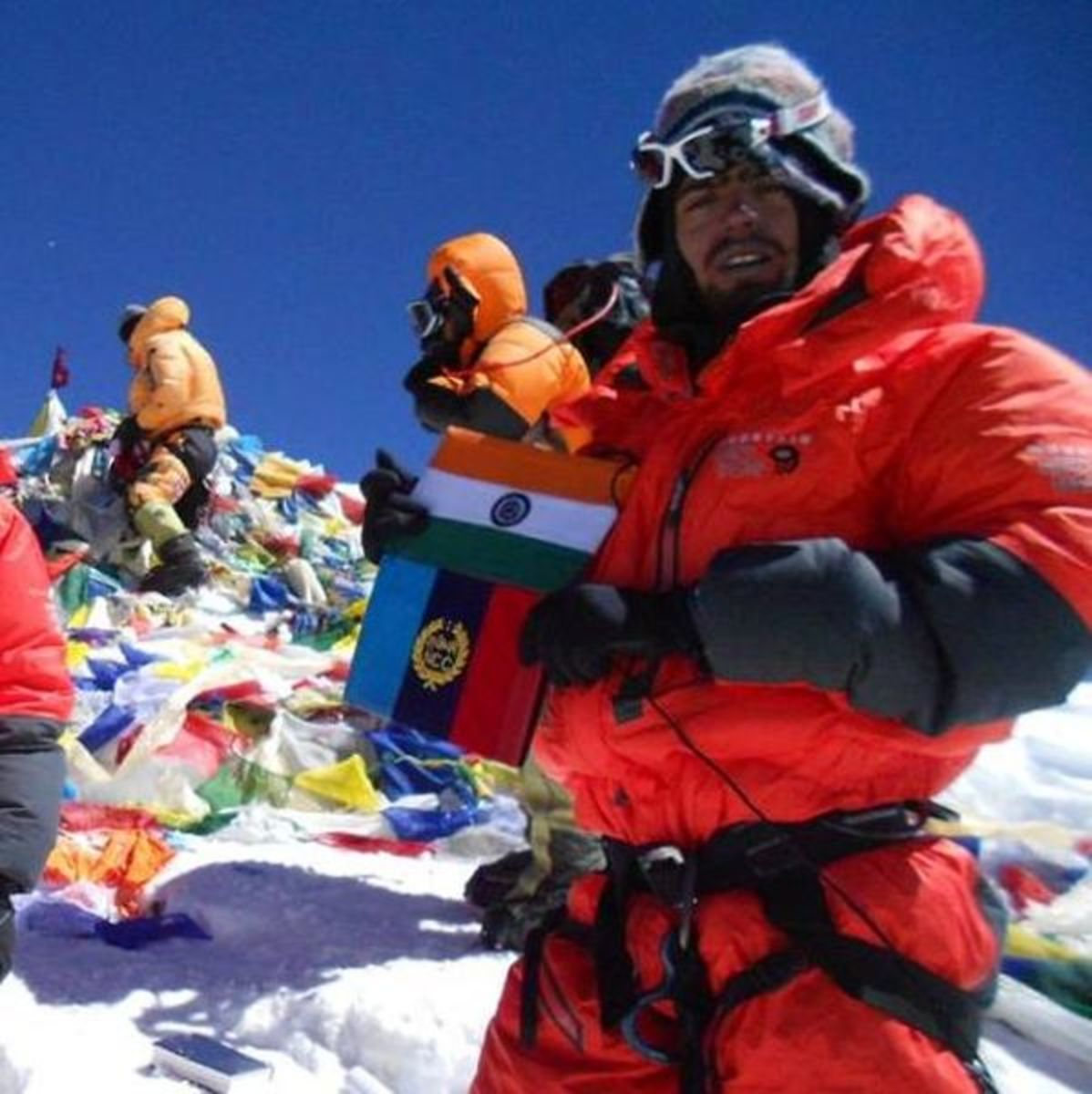 Many climbers leave flags at the summit.