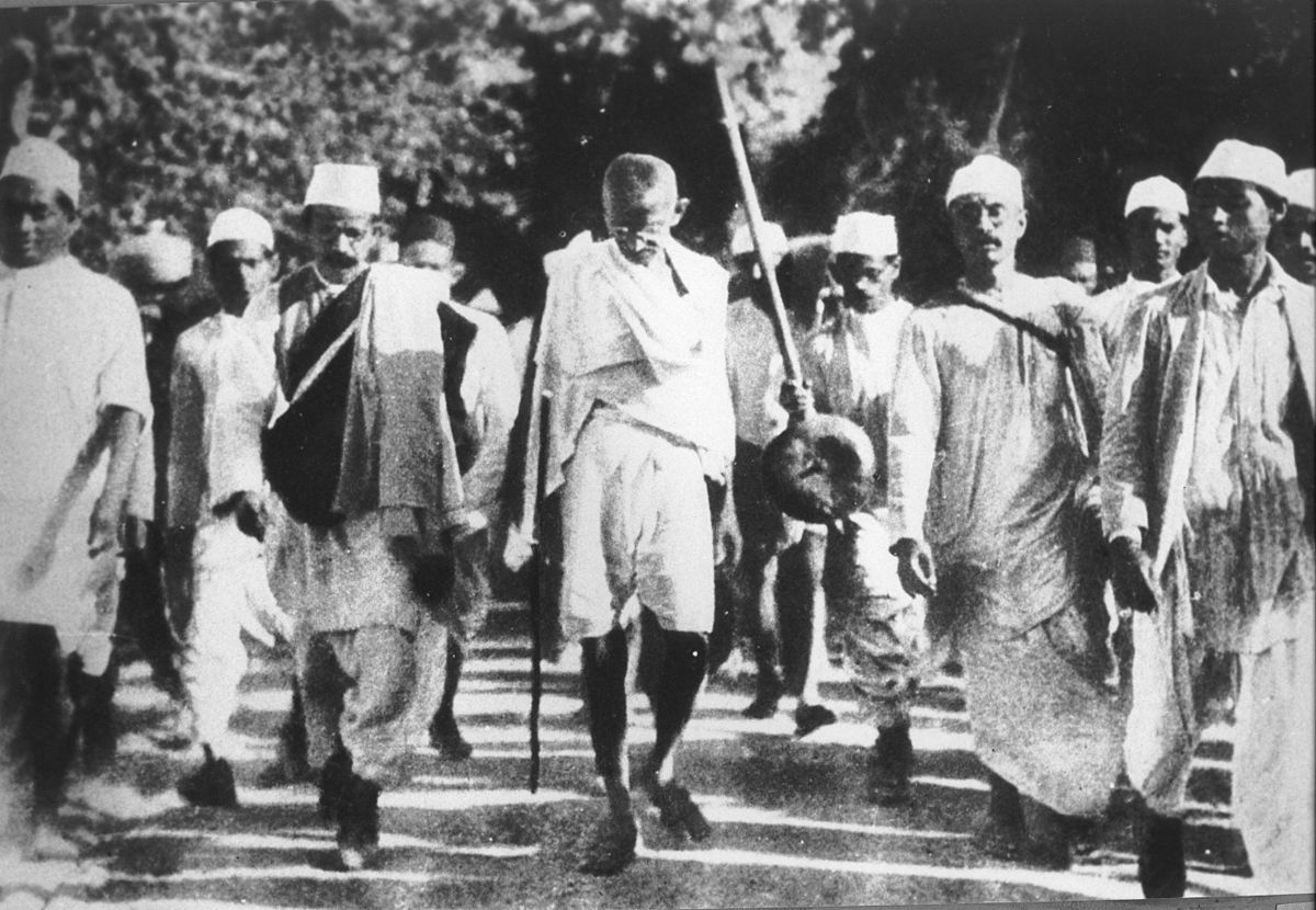 Gandhi (centre) leads his fellow salt marchers.