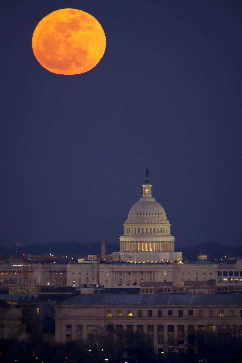 Full moon over Capitol Building