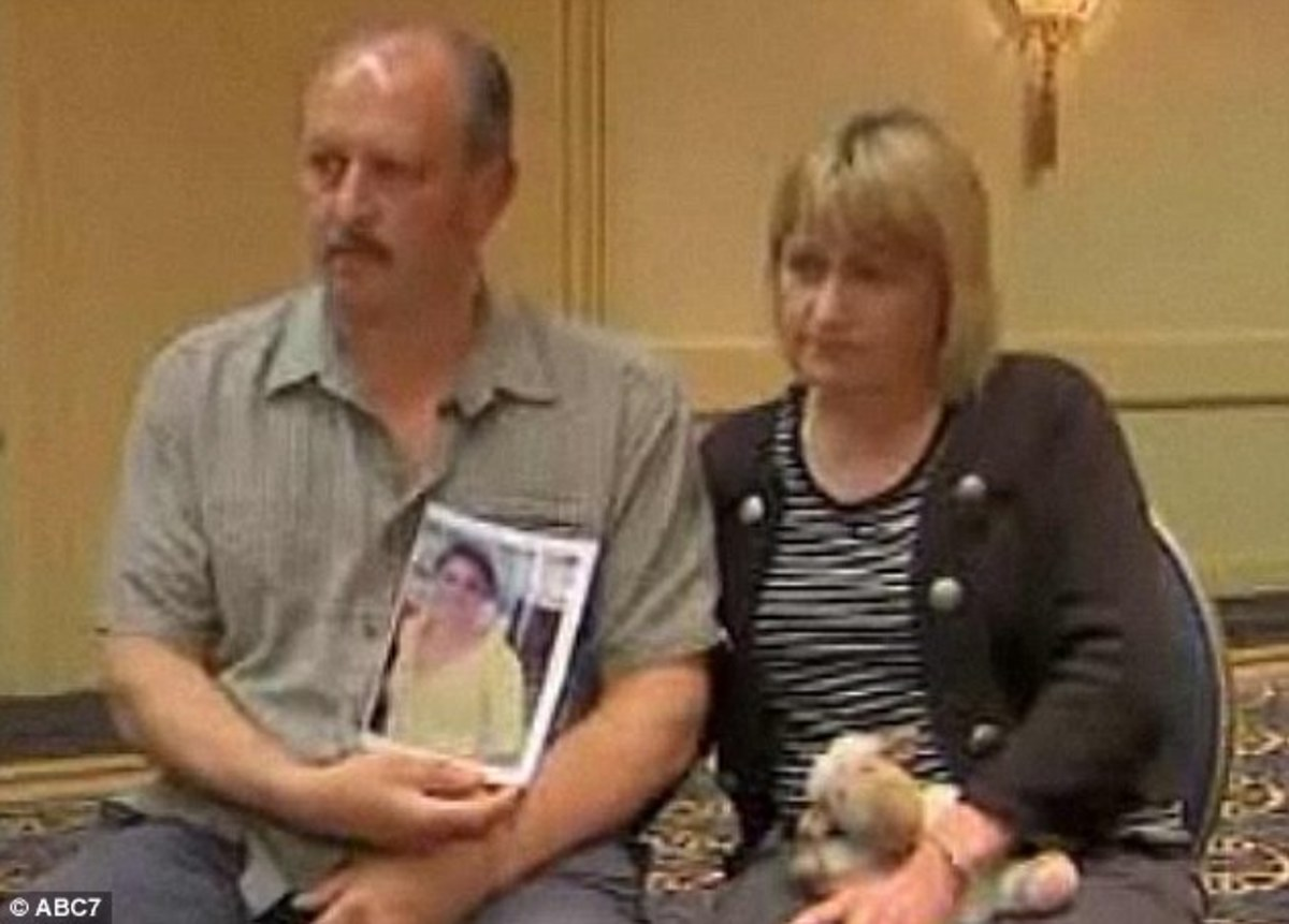 Rebecca's parent's holding her photo. They are still looking for answers.