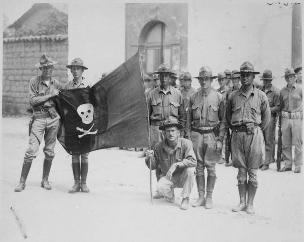 In Nicaragua 1932 U.S. Marines hold the captured flag of Nicaraguan revolutionary leader Augusto César Sandino.
