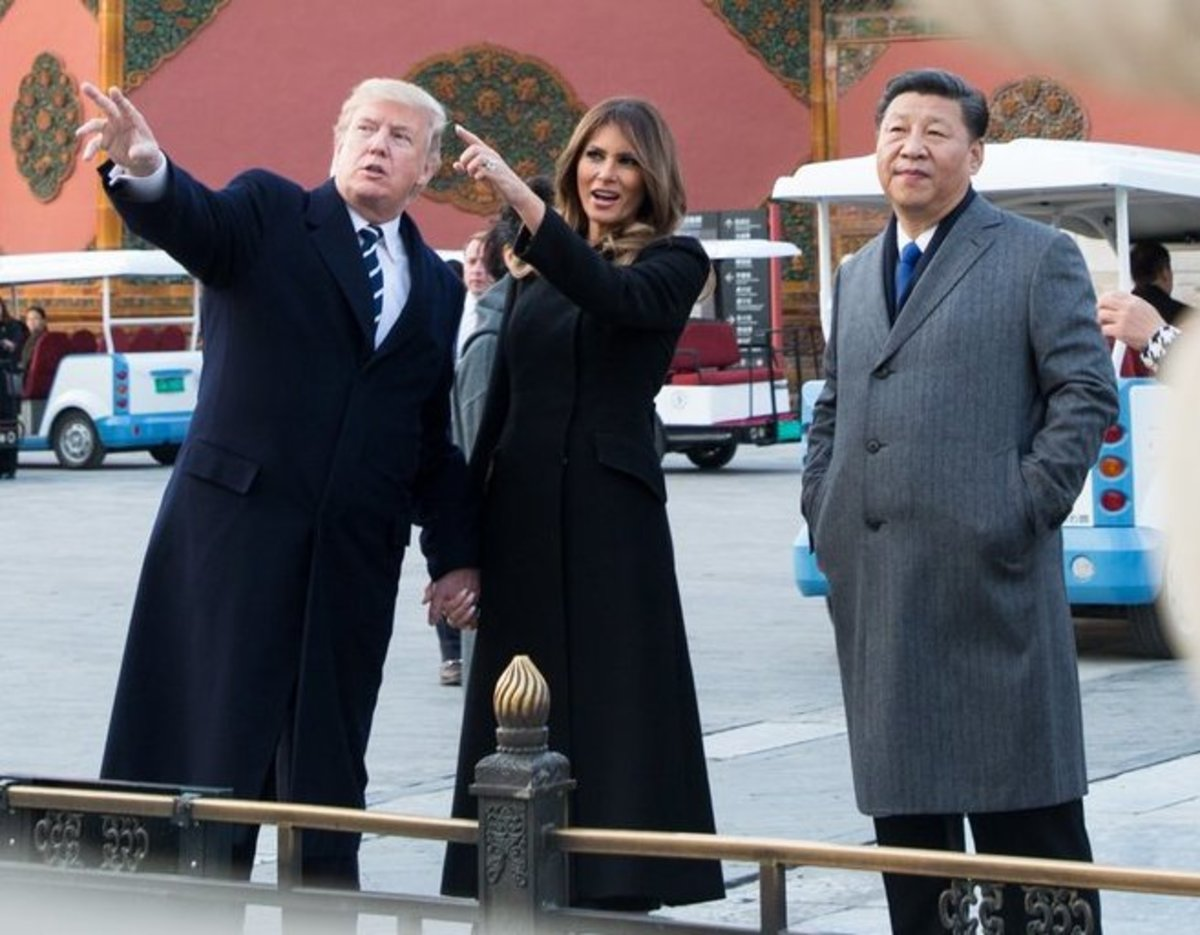 Photograph of U.S. President Donald Trump and First Lady Melania Trump visit Beijing, China accompanied by Chinese President Xi Jinping (2017); photograph by U.S. government employee courtesy of Wikimedia Commons. Work is in the public domain.