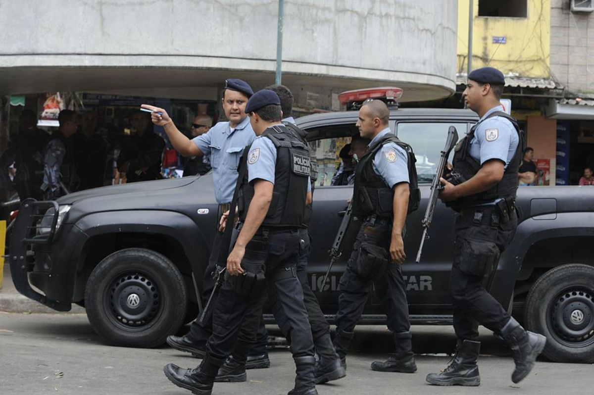 Police officers in the favela of Rocinha. Brazil suffers from high crime and murder rates.
