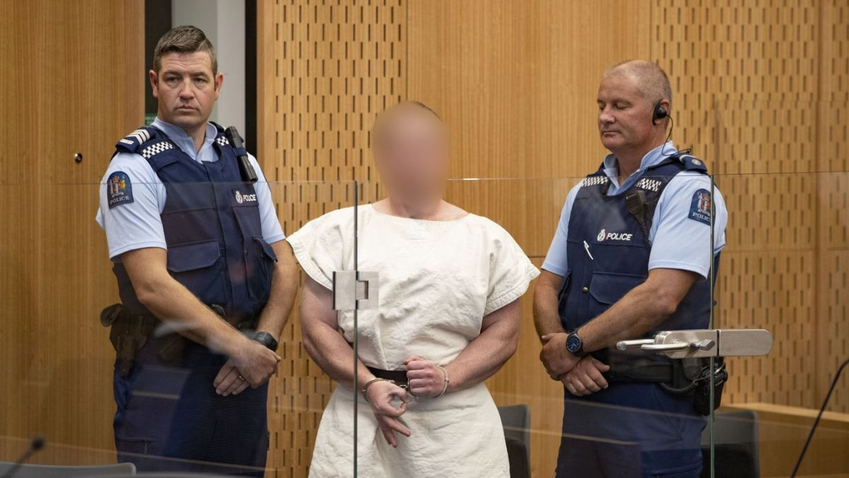 """Mosque attacks suspect gives """"white power"""" sign in Christchurch court."""