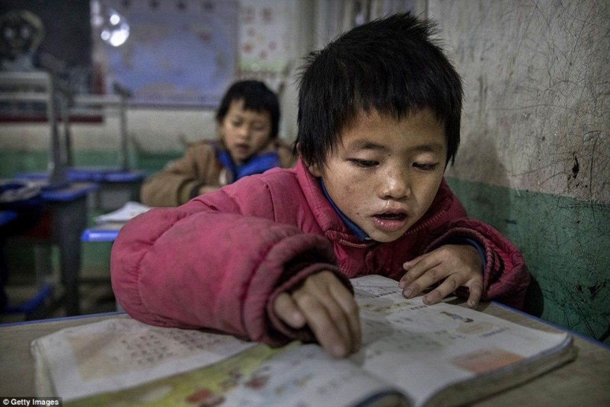 Young Luo Hongniu, aged eight, is being raised by his grandparents in the rural province of Anshun (DailyMail.com - 2017)