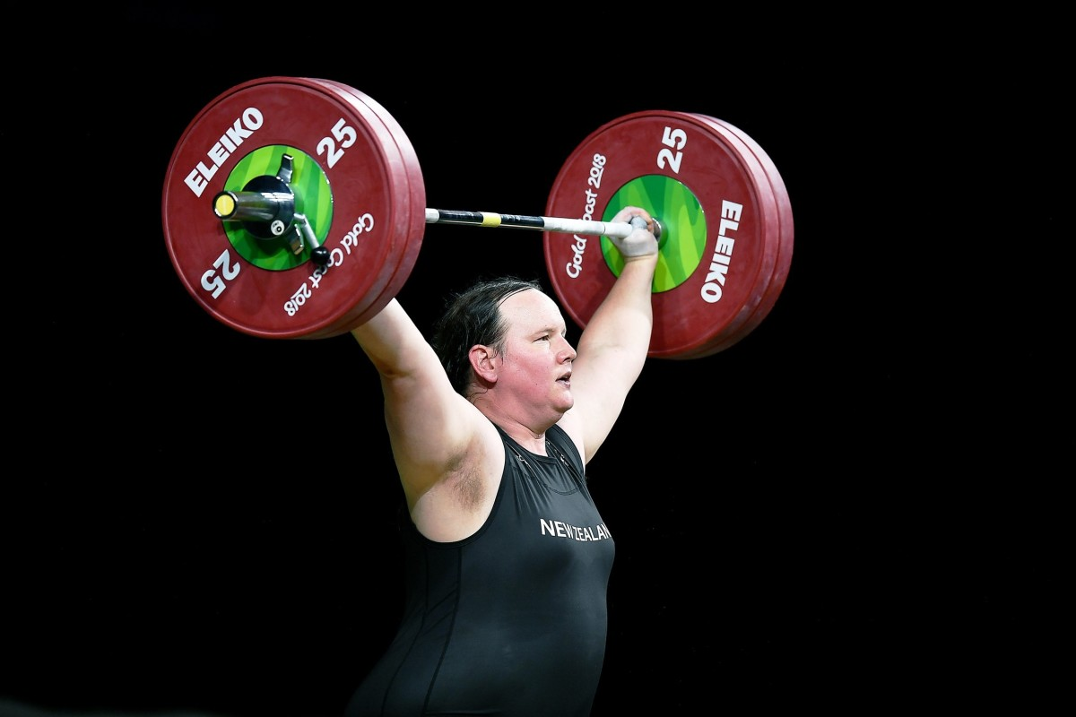 Gold medalist weightlifter Laurel Hubbard mid-lift.