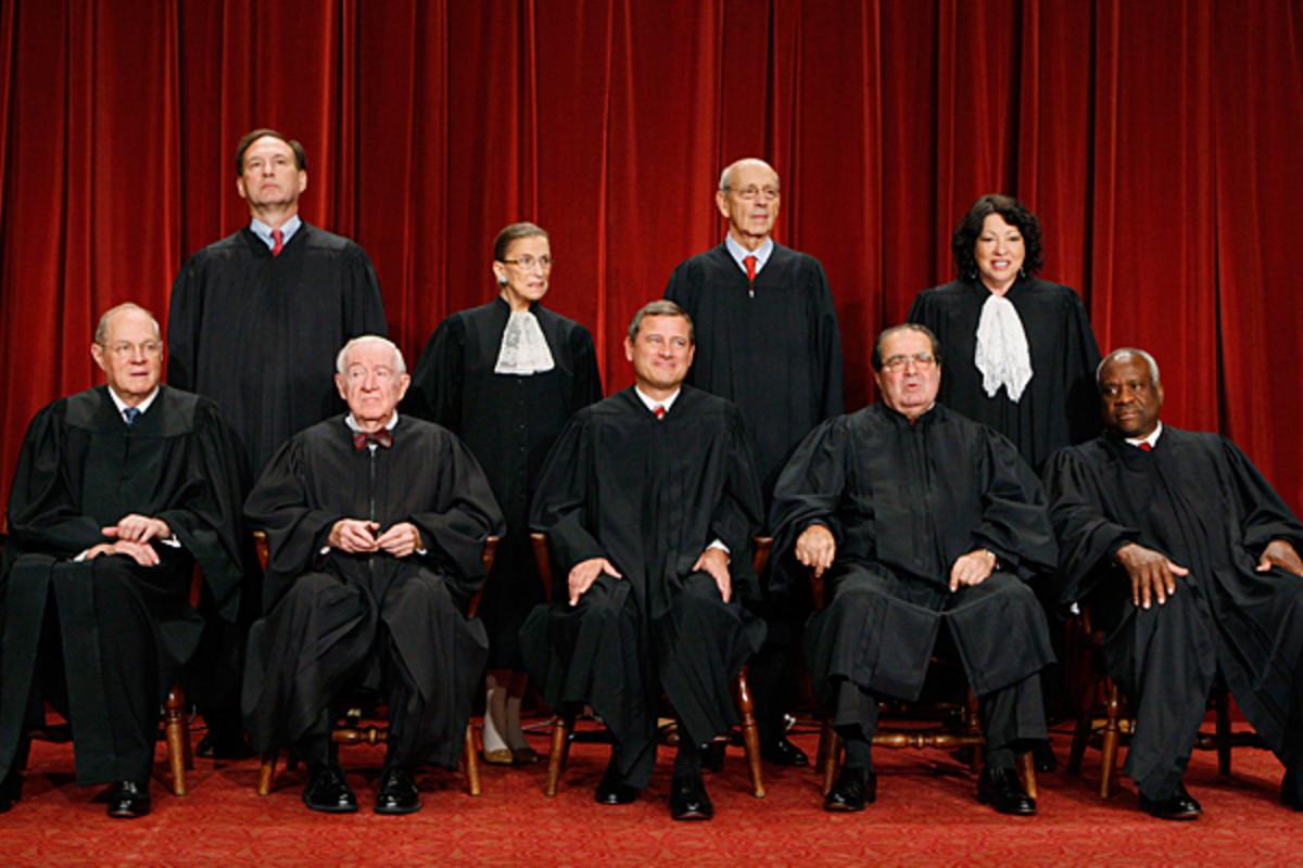 2009-2010 Supreme Court. Front L-R: Kennedy, Stevens, Roberts, Scalia, Thomas.  Back Row: Alito, Ginsburg, Breyer, Sotomayor.  Unlike his colleagues, Thomas went years without asking a single question.