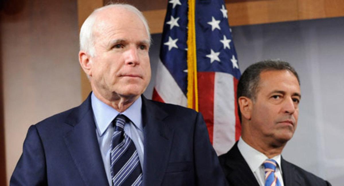 The late Senator John McCain (AZ) and Senator Russ Feingold (WI).