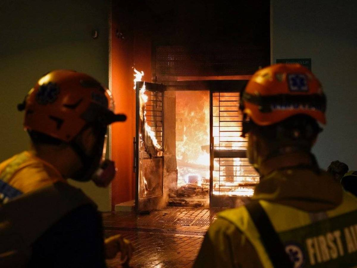 Petrol bombs were thrown at the lobby of a residential compound  in protest against a plan to turn the building into a quarantine zone.