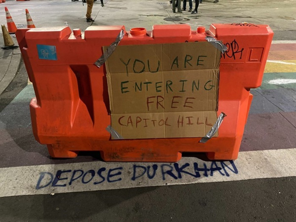 a sign on a CHAZ barricade, referencing Northern Ireland's Free Derry