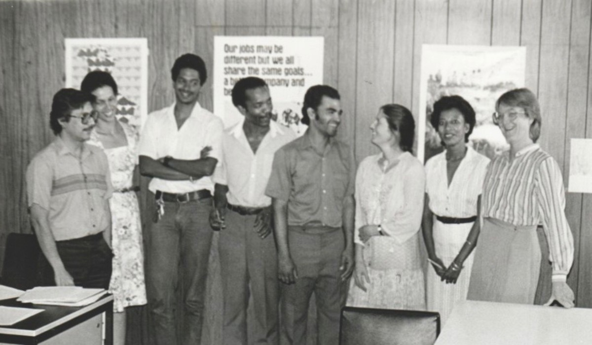 This photograph was taken by a client named George. I am standing on the far right wearing glasses. The three on the left were my field officers. The Executive Director is next to them.