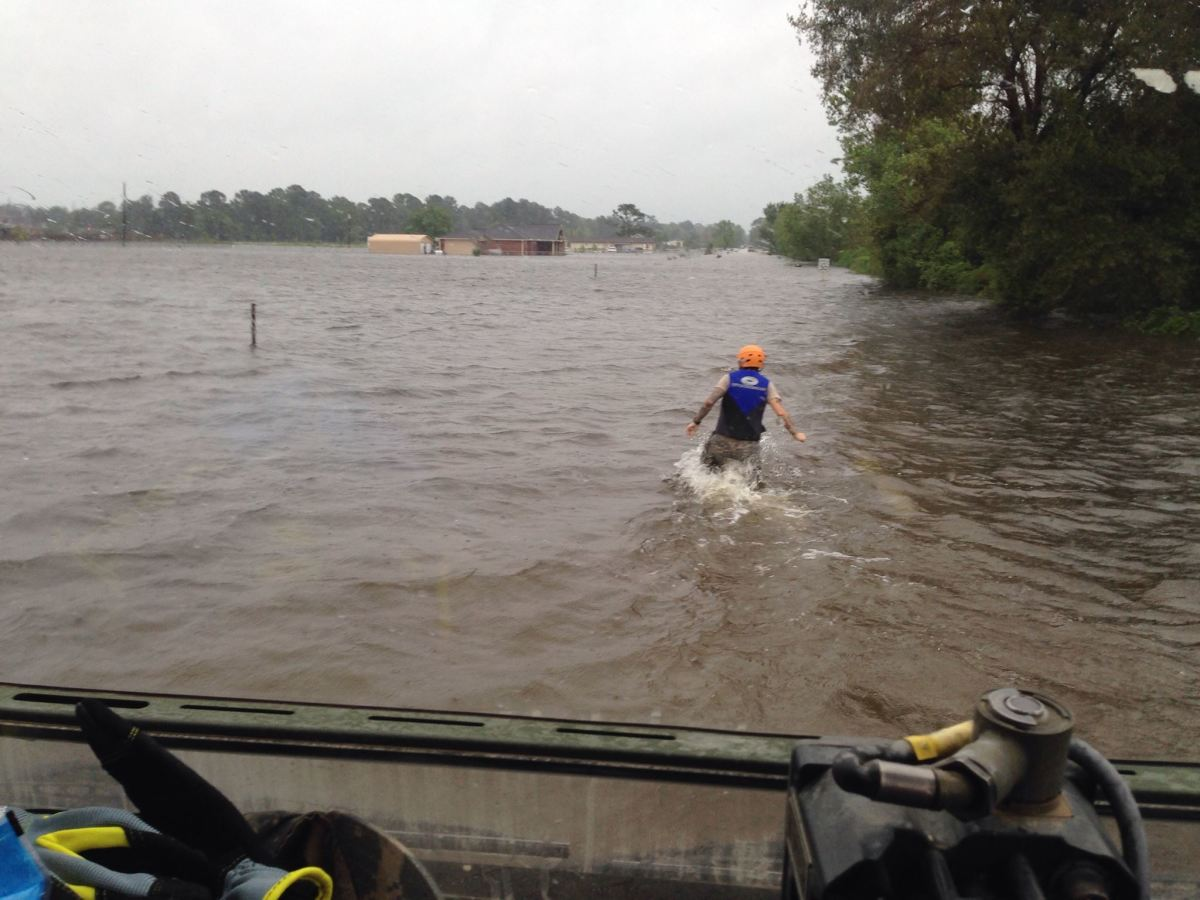Conducting water rescues in a Houston neighborhood during Hurricane Harvey.