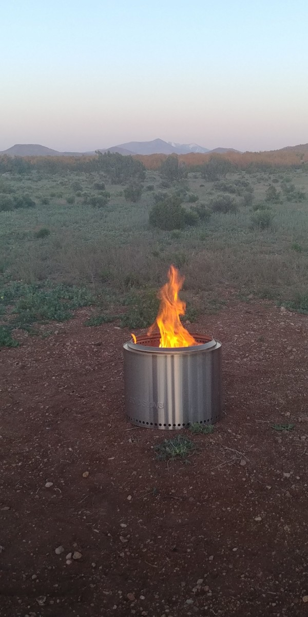 Our Solo Stove in action in a clearing on our property, with a view of the San Francisco Peaks near Flagstaff, AZ.