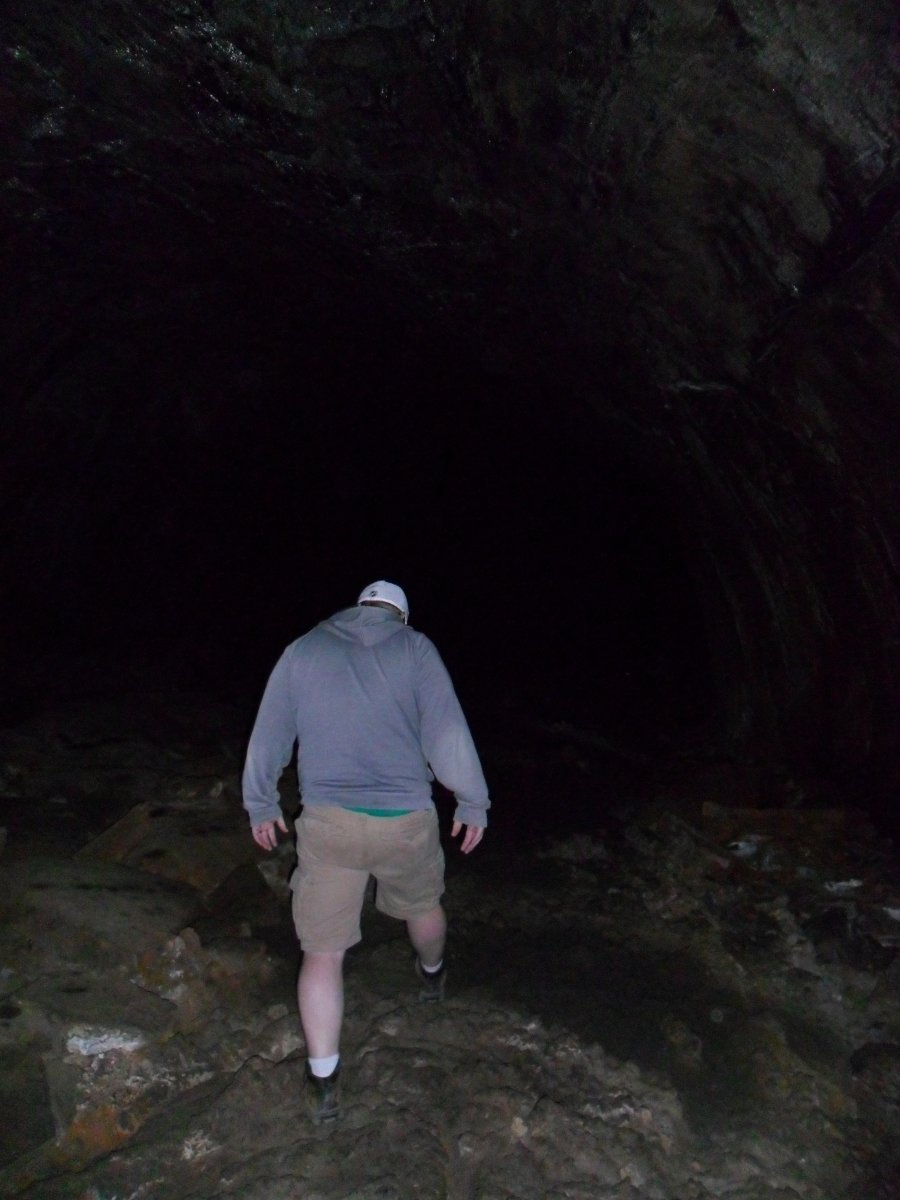 My son, Jeff in the Lava River Cave. You can see some ripples in the floor near his left foot.