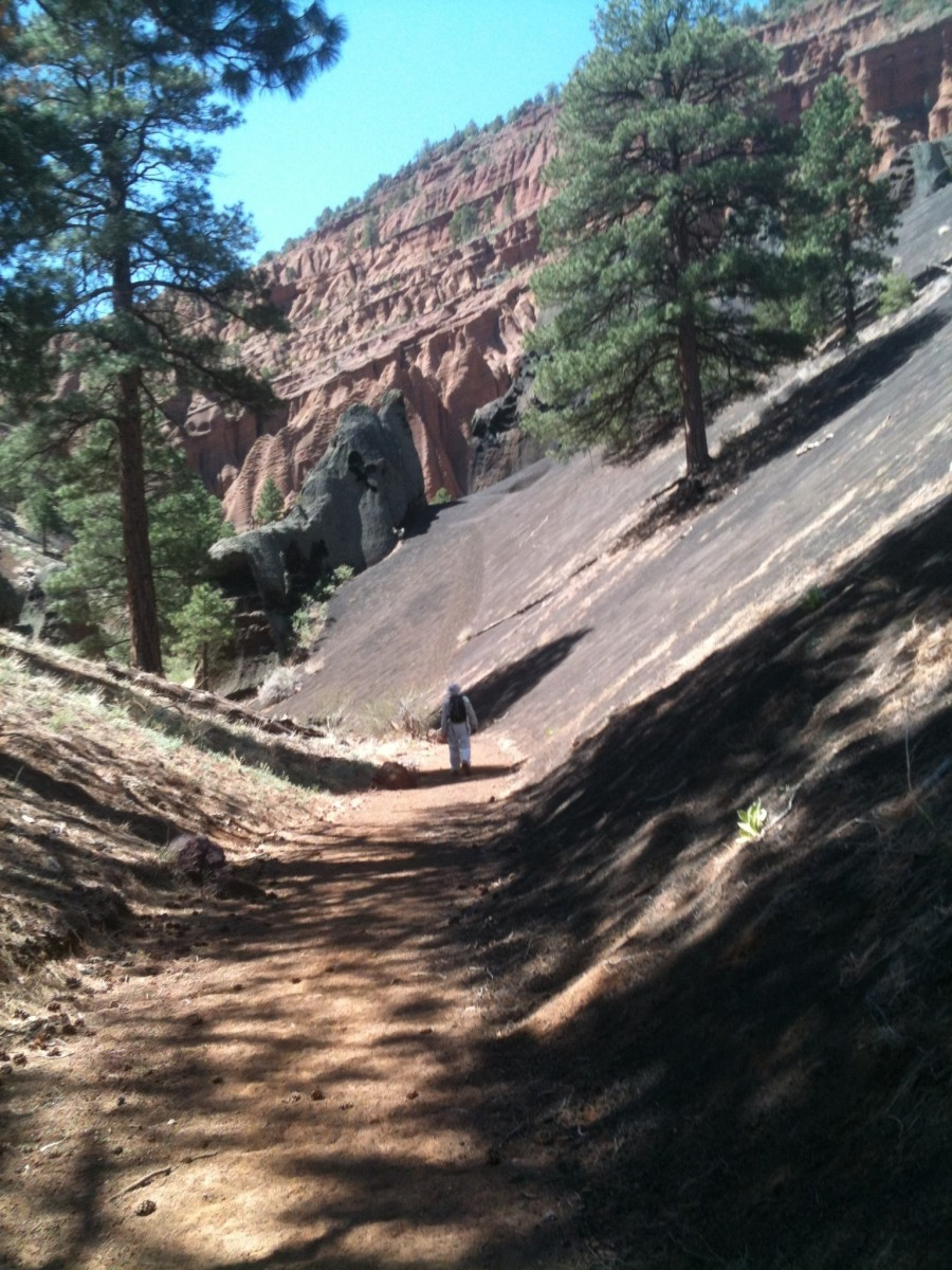 Hiking the trail and getting close to the amphitheater.  Notice the lava cinders on the right.
