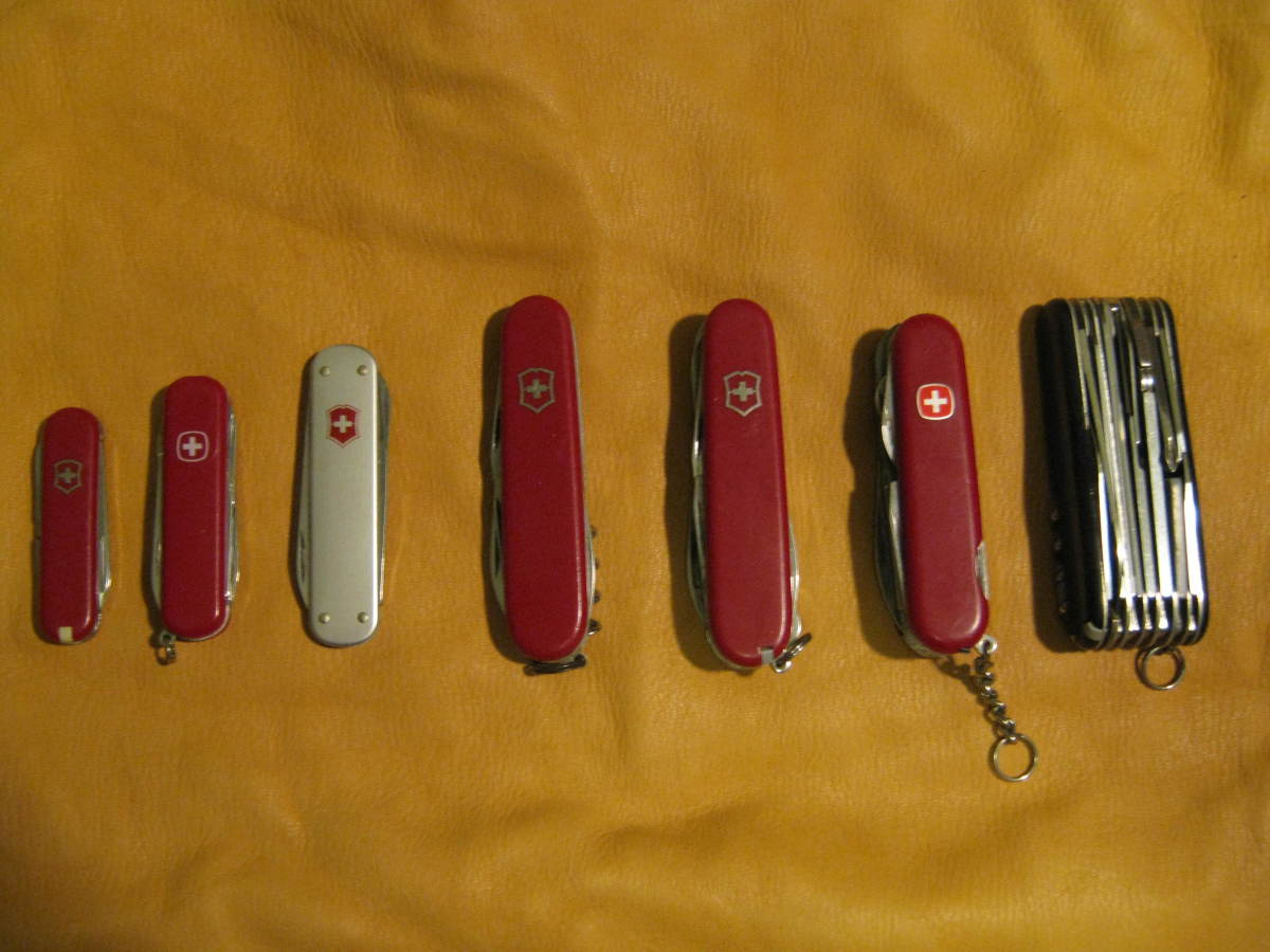 A few Swiss Army Knives from my collection, notice the thick Swiss Champ on the far right.