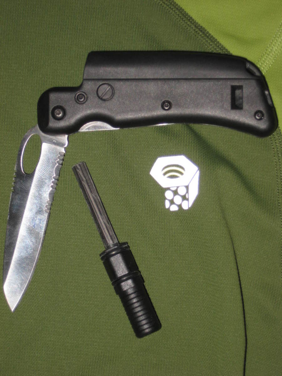 This Tool Logic knife has a partially serrated blade, a whistle in the handle and a ferrocerium sparker.