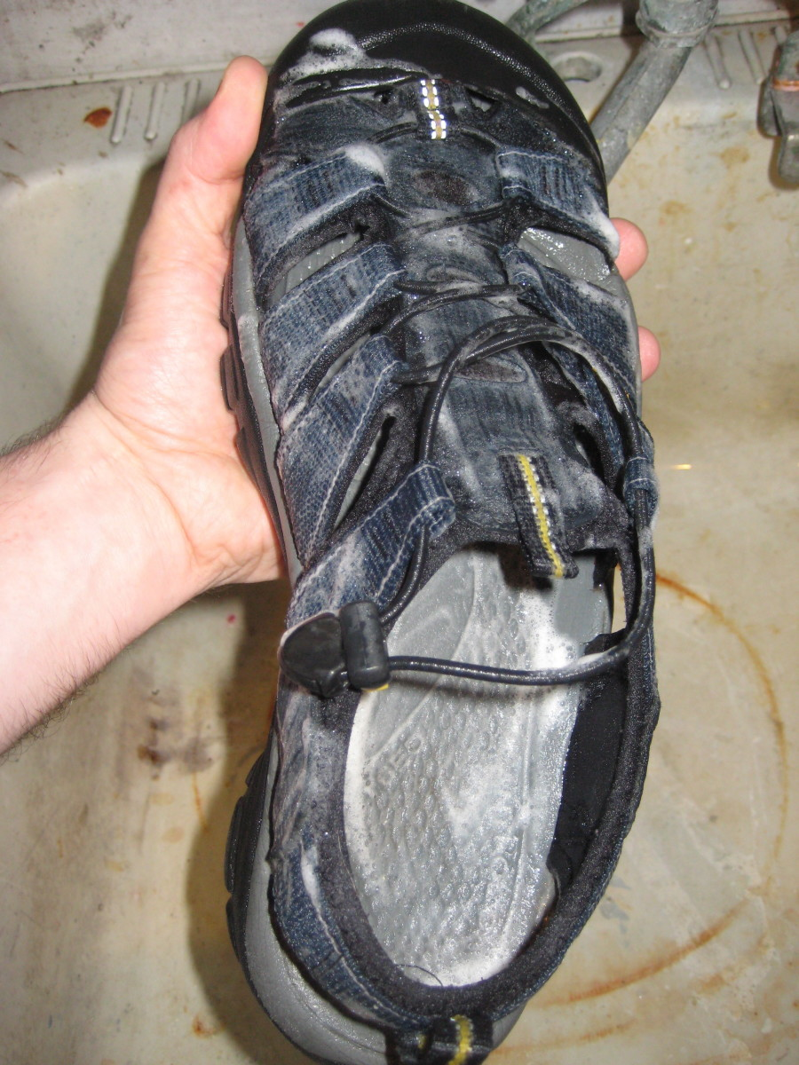 Lather the soap on the footbed and webbing.