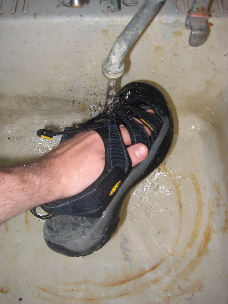 Before adding soap, thoroughly wet the sandal and scrub away loose dirt.