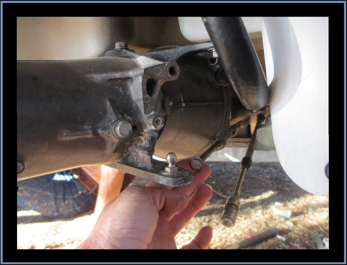 Remove the upper and lower long bolts on each side.