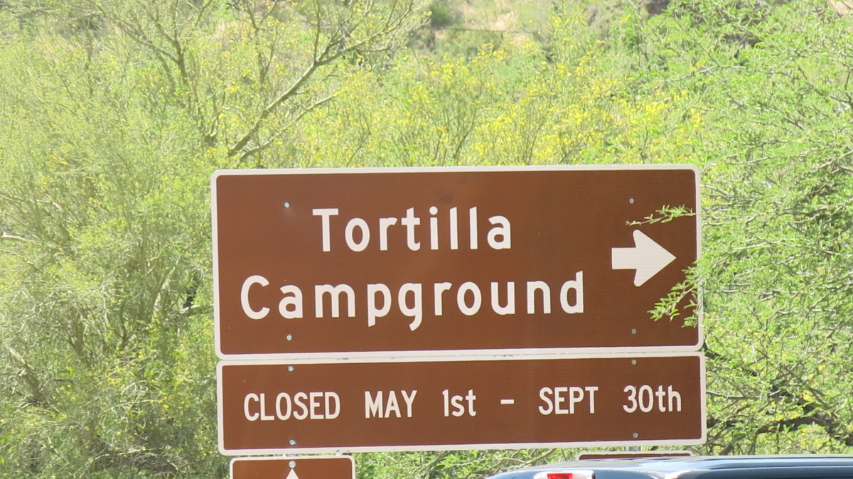 Sign shows Campground by Canyon Lake closed May 1-Sep 30.  Winter, not Summer, is the tourist season here.