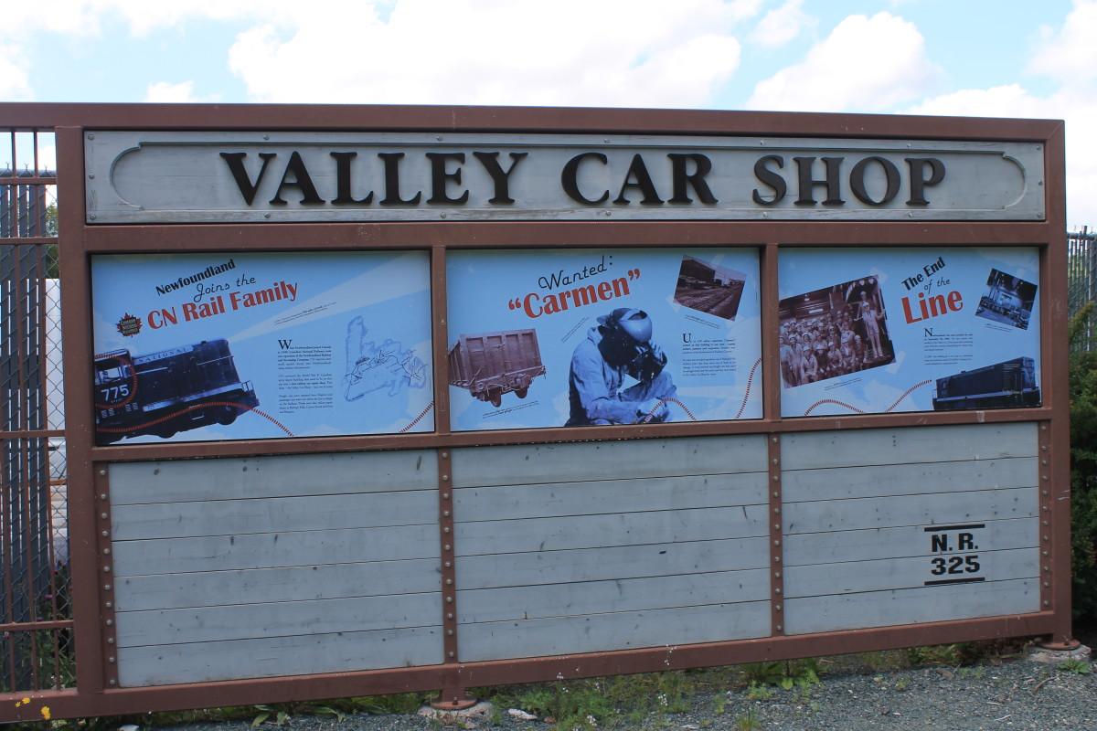 Trailside story board about the railway and the Valley Car Shop.