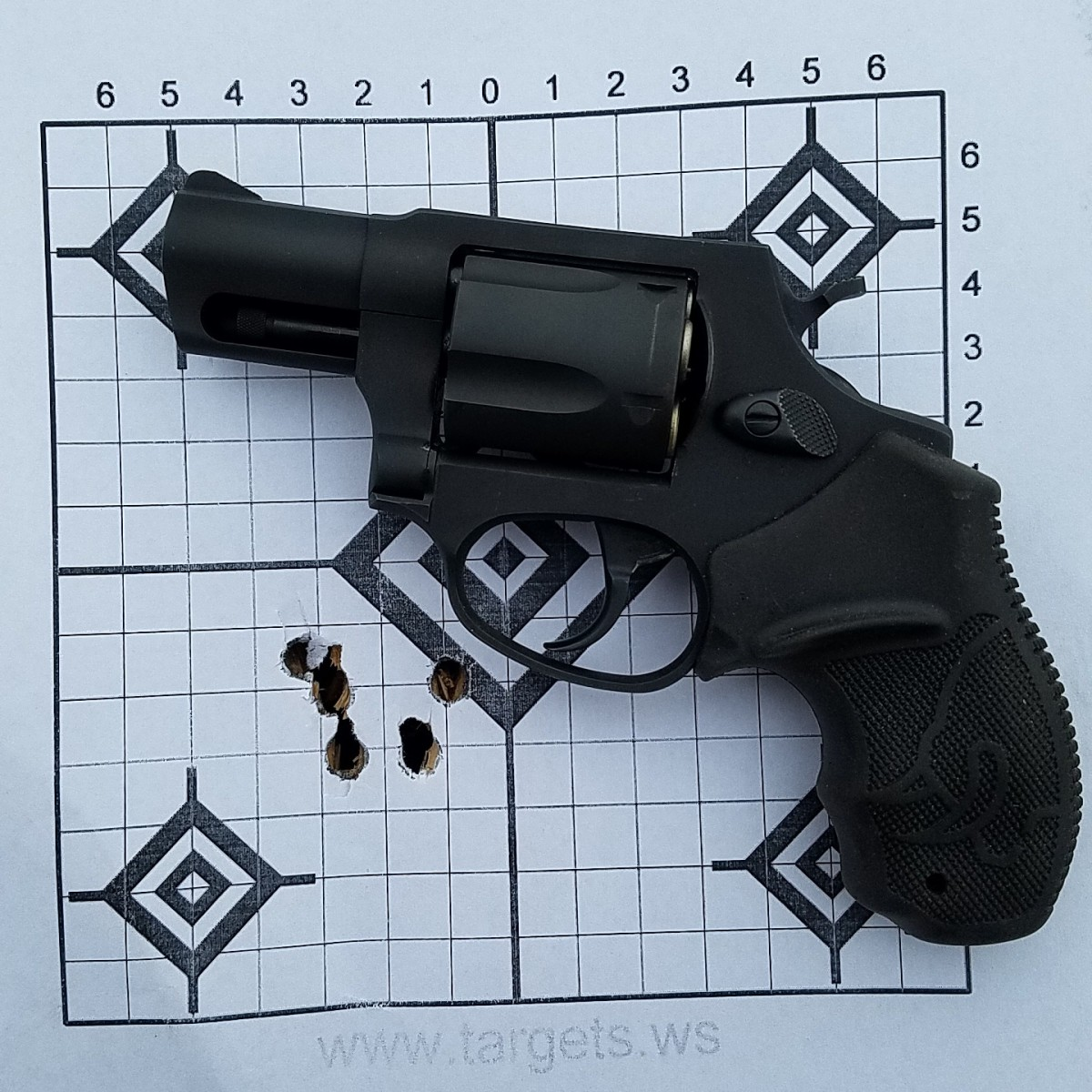 Very first group fired from the Taurus at 15 yards, shooting 130 grain cast  hand loads.