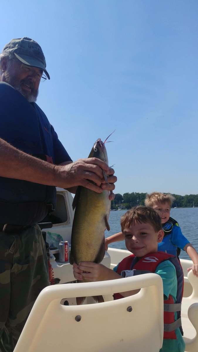Big catfish and small Kid !