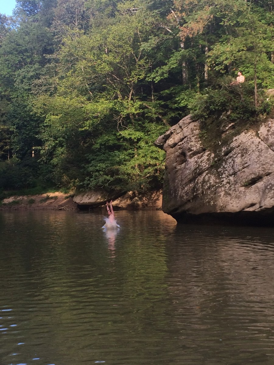 Cliff Jumping Into the River Close to Our Campsite