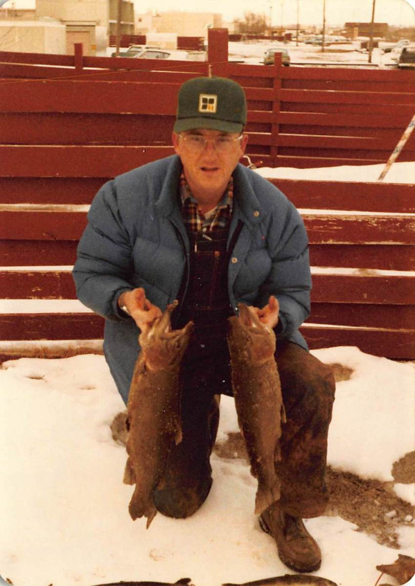 Dad circa 1978 with two monster trout he caught at a lake he called Unnamed