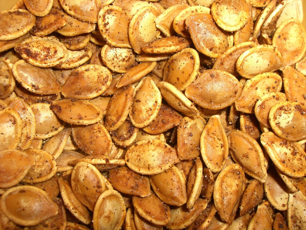 My oven roasted pumpkin seeds weren't as beautiful as this, but they were good tasting.  They are a good source of zinc.  You can also roast squash seeds.