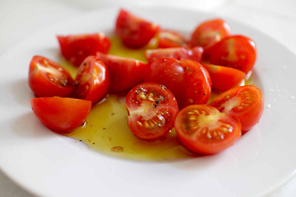 Consuming tomatoes either raw or cooked with olive oil (that's the key) increases blood lycopene levels which helps prevent cancer.