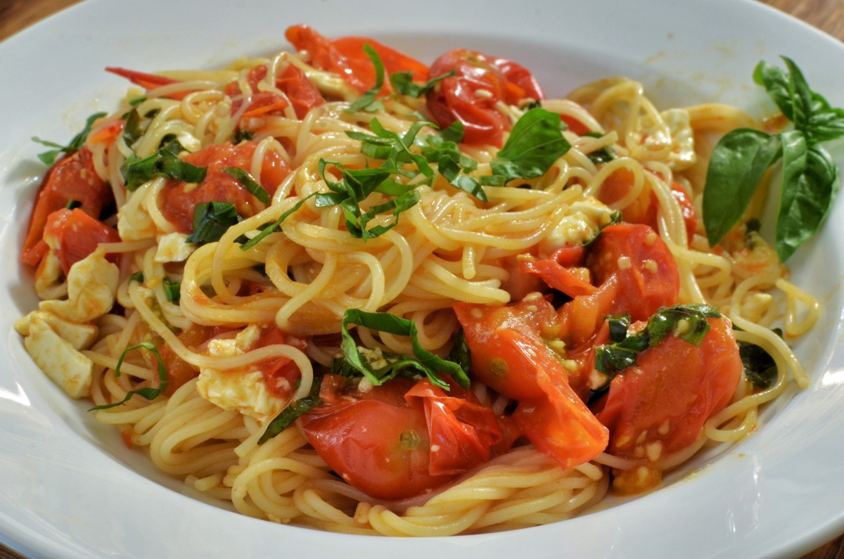 Don't worry.  You're not going to starve.   You can find good stuff to eat like this dish of sauteed cherry tomatoes on angel hair pasta.  Just watch the ingredients listings.