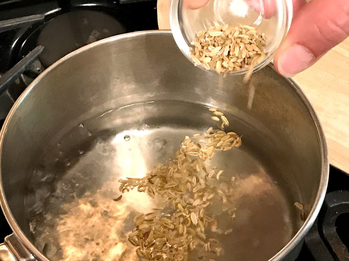When the water starts bubbling, toss in the fennel seeds and switch off the heat.
