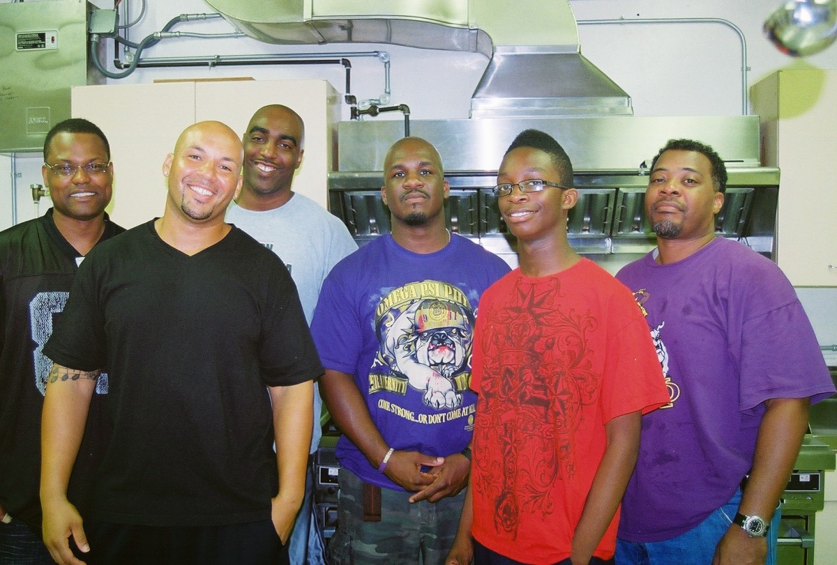 Volunteers and members of Psi Nu Chapter of Omega Psi Phi Fraternity, Inc. are regulars at the bi-weekly program.