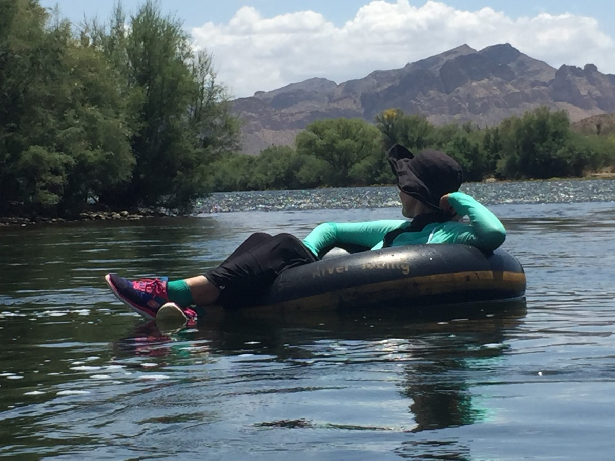 My wife escaping the July heat and enjoying the passing scenery as she floats down the Salt River in a giant inner tube.