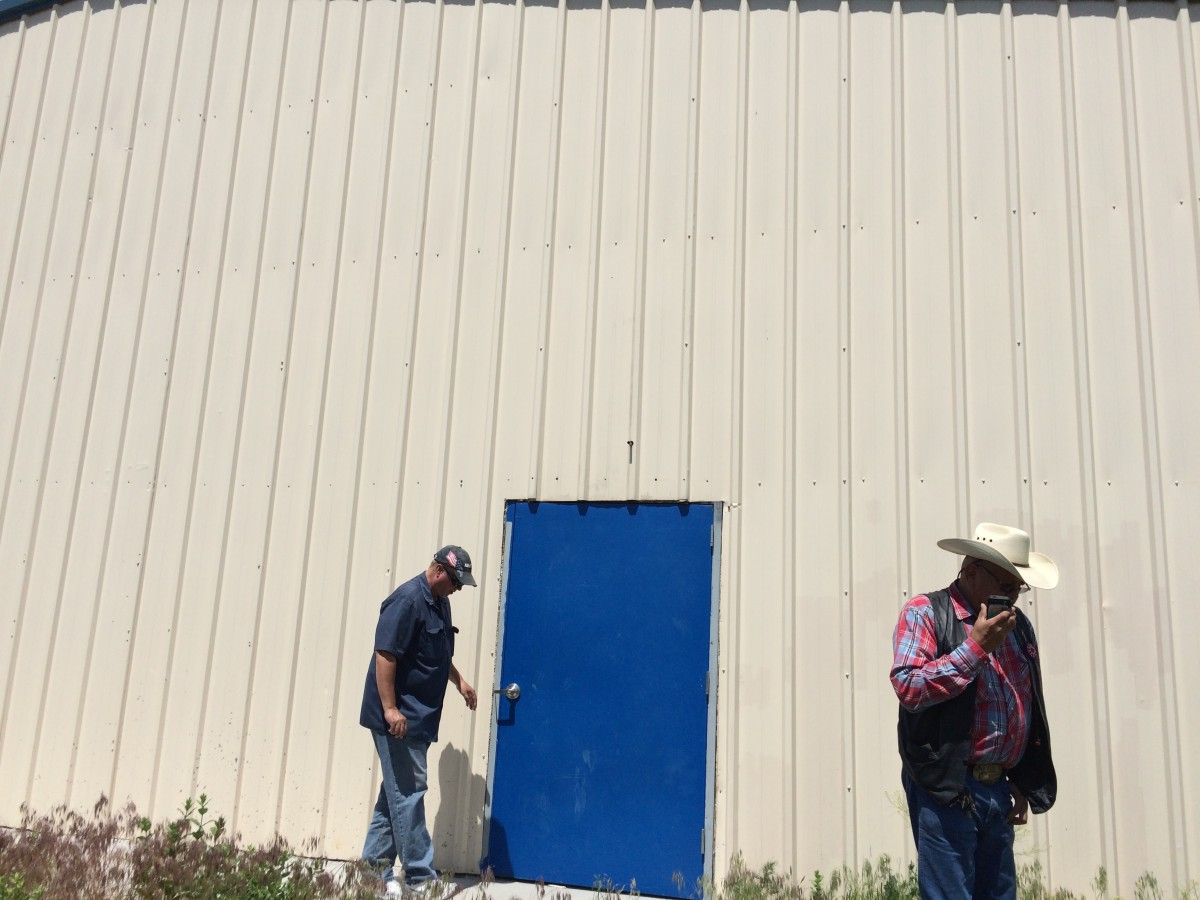 We checked out this abandoned structure in the heart of Wounded Knee. Brian is on the left. A local who unlocked the building for us is on the right.