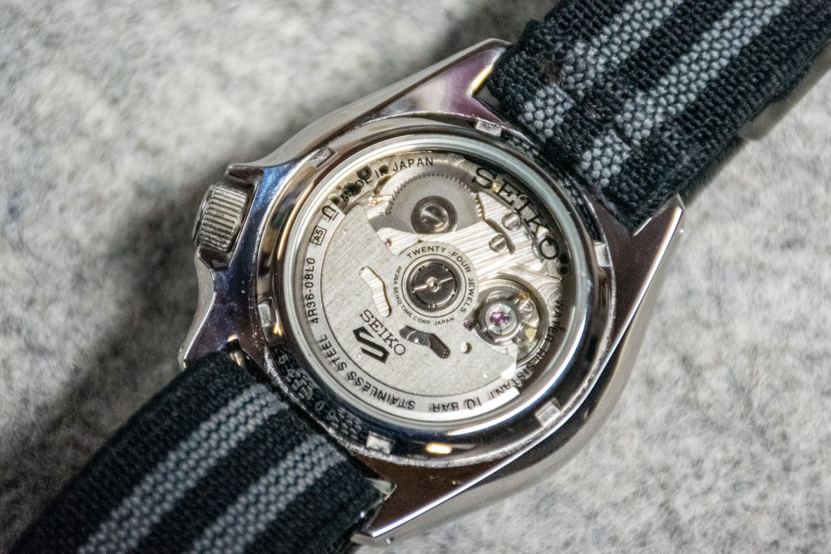 The see-through case back on the SRPE67 shows the Seiko 4R36 movement