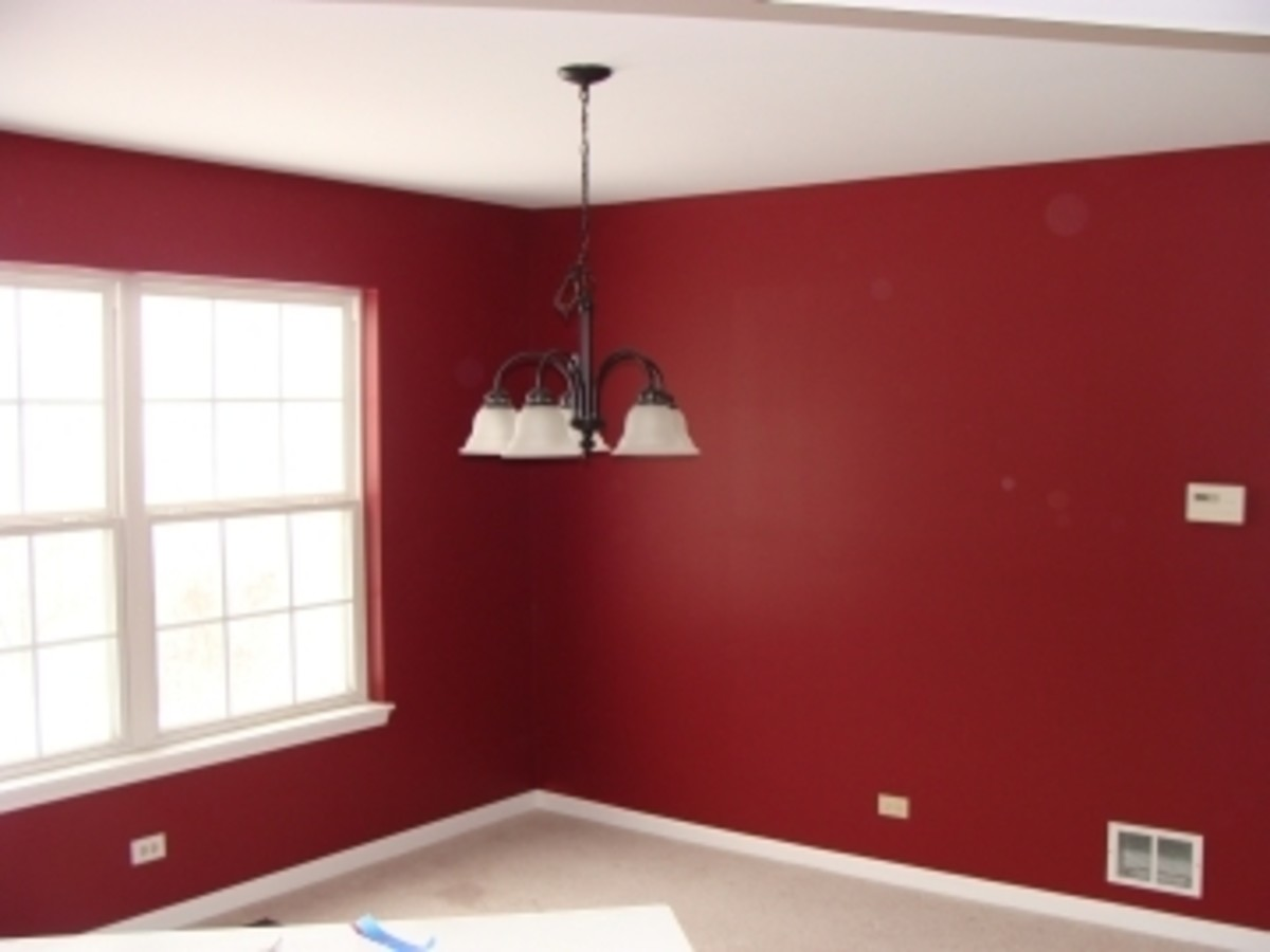 A dining room I primed and painted red.