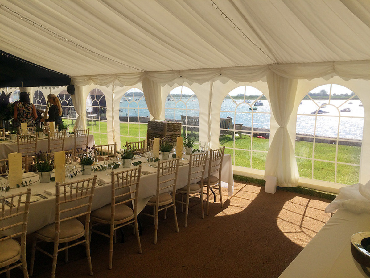 This tent features cathedral walls (walls with windows), which allow for plenty of natural light while protecting guests from wind.
