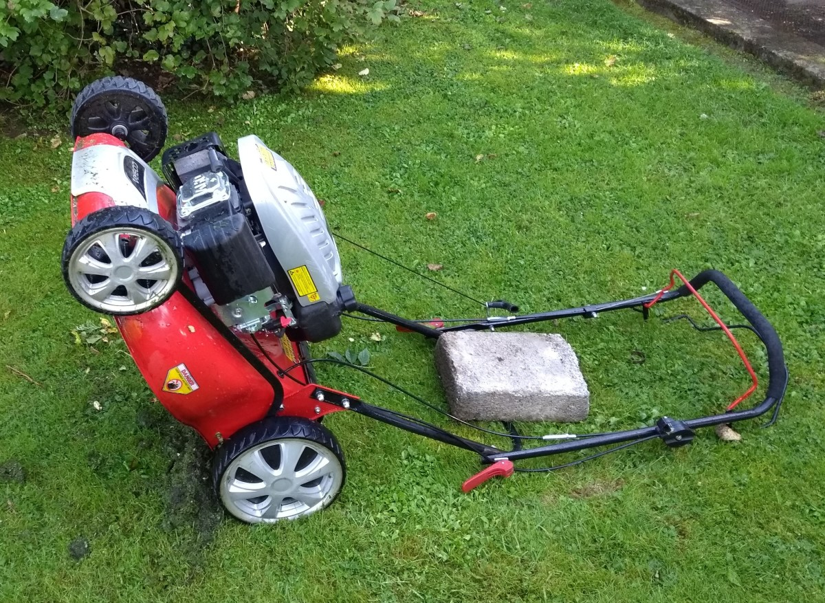 ......alternatively the mower can be placed back on its handles with a heavy weight such as a concrete block to keep it in place.