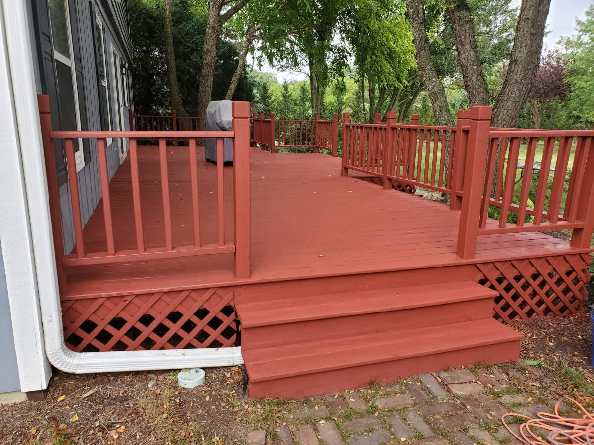 A deck I stained with Sherwin Williams Super Deck. The color is Brick.