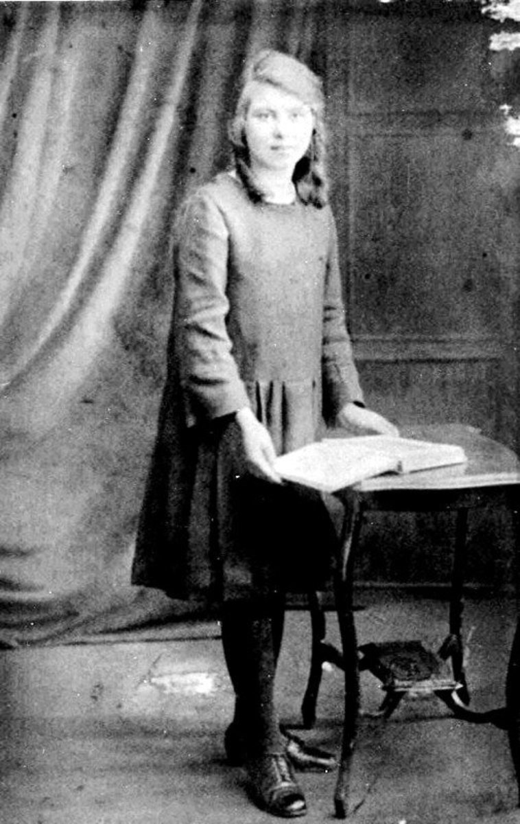 Bridget Maguire was 12 years old in 1921 in Dublin Ireland.  She played out in the street where the Black and Tans would drive up in their lorries.